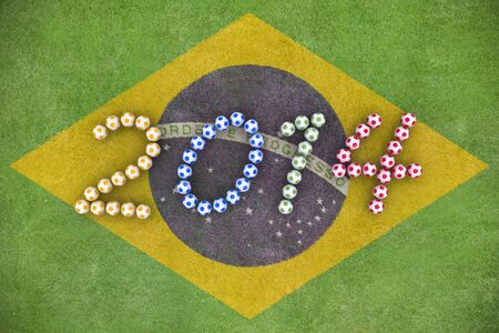 3D rendering of footballs form in to the year 2014 over a painted grass field of Brazil Flag Stock Photo - 18845802