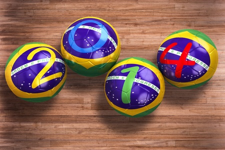 3D rendering of footballs in the year 2014 ion the floor Stock Photo - 18836910