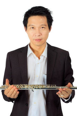 Isolated professional flute player on white photo