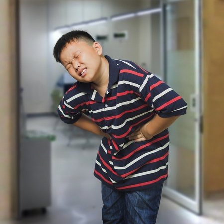Young asian boy with an abdominal pain photo