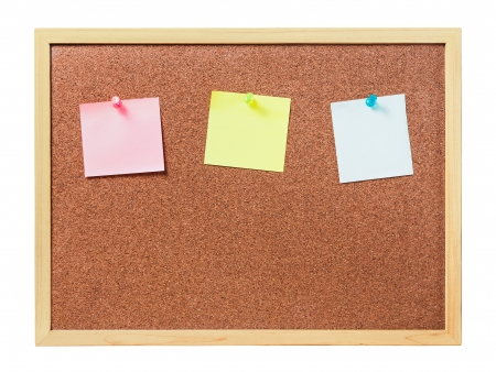 cork board with plastic pins and blank notes photo