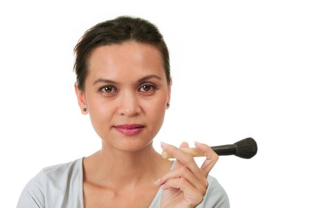 make up brushes: Isolated asian woman holds make up brushes