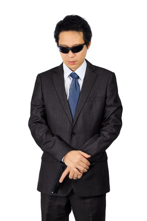 Isolated asian male with a gun on white Stock Photo - 21483025