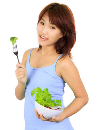 Isolated young asain woman with a bowl of vegetable salad