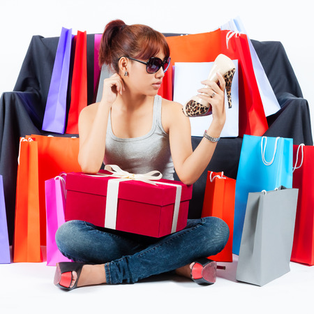 Isolated Young Asian Woman with Shopping Bags photo