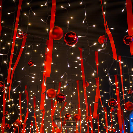 pretty s shiny: Decorated red balls white small lightbulbs for christmas on the ceiling