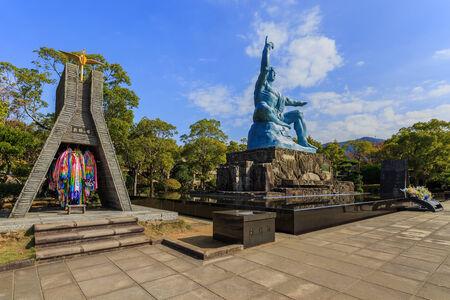 eradicate: NAGASAKI, JAPAN - NOVEMBER 14: Nagasaki Peace Park in Nagasaki, Japan on November 14, 2013. A 10-meter-tall peace statue created by sculptor Seibou Kitamura of Nagasaki Prefecture