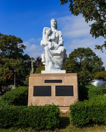 nagasaki: NAGASAKI, JAPAN - NOVEMBER 14  Nagasaki Peace Park in Nagasaki, Japan on November 14, 2013  Statue of Peace in Peace Symbols Zone from the Union of Soviet Socialist Republics