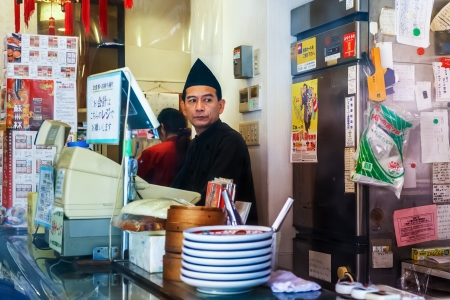 shop keeper: NAGASAKI, JAPAN - NOVEMBER 14: Remen restaurant in Nagasaki, Japan on November 14, 2013. Unidentified ramen shop keeper, specialize in Champon and Saru Udon, in Nagasakis Chinatown