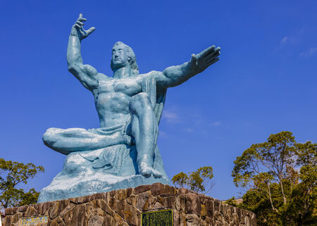 eradicate: Nagasaki, Japan - November 14 2013: Nagasaki peace statue, the statues right hand points to the thret of nuclear while the extended left hand symbolizes eternal peace Editorial
