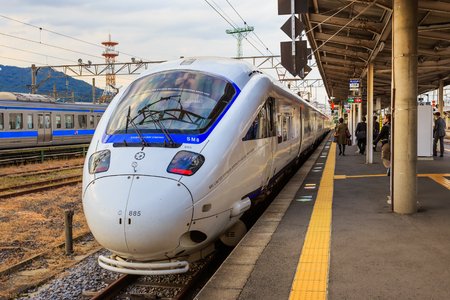 NAGASAKI, JAPAN - NOVEMBER 14  Limited express in Nagasaki, Japan on November 14, 2013  Sonic 885 is an AC electric multiple unit tilting train type operated on limited express services by JR Kyushu