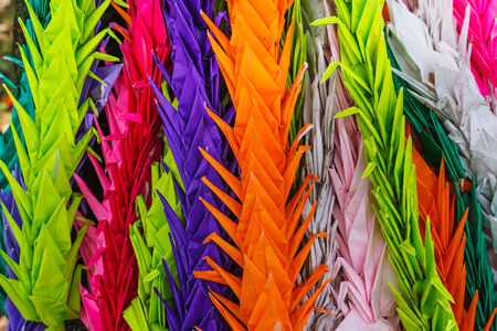 central park: Colorful paper folded vranes at Hiroshima Central Park Stock Photo
