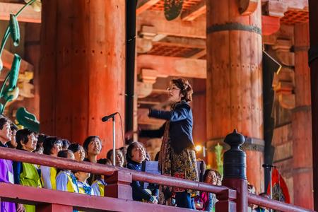todaiji: NARA, JAPAN - NOVEMBER 16  Daibutsu Praising in Nara, Japan on November 16, 2013  Unidentified local choir group sing praise at the Daibutsu-den to the Great Buddha at Todaiji Temple