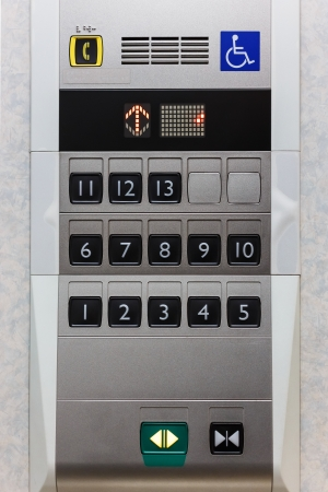 Elevator panel with push buttons for normal people and hadicapped person photo