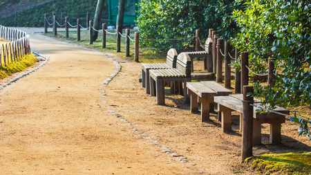 okayama: Wood benches and chairs at Koraku-en garden in Okayama