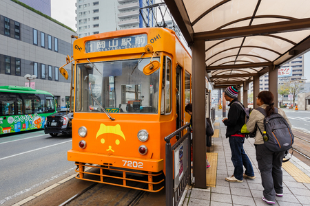 kita: OKAYAMA, JAPAN - NOVEMBER 17  Okayama Street car in Okayama, Japan on November 17, 2013  Only cover a small area in central Okayama city  1 day pass available for 400 Yen