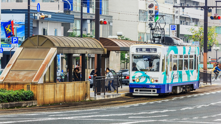 okayama: OKAYAMA, JAPAN - NOVEMBER 17  Okayama Street car in Okayama, Japan on November 17, 2013  Only cover a small area in central Okayama city  1 day pass available for 400 Yen
