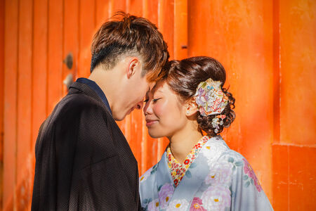 KYOTO, JAPAN - NOVEMBER 18  Japanese Couple in Kyoto, Japan on November 18, 2013  Unidentified groom and bride dress traditional costume for their wedding ceremony