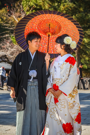 KYOTO, JAPAN - NOVEMBER 19  Japanese Couple in Kyoto, Japan on November 19, 2013  Unidentified groom and bride dress traditional costumes for their wedding ceremony