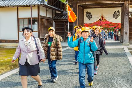 rokuonji: Kyoto, Japan - November 20 2013  Unidentified group of Japanese students with teachers make a field trip at the Kinkakuji temple