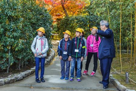KYOTO, JAPAN - NOVEMBER 20  Ginkakuji in Kyoto, Japan on November 20, 2013  Aroup of Japanese students with teacher make a field trip at the Ginkakuji temple