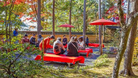 KYOTO, JAPAN - NOVEMBER 20  Tea Garden in Kyoto, Japan on November 20, 2013  A small tea garden at Kinkakuji where people can have matcha tea and sweets  Stock Photo - 26944927