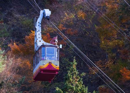kawaguchi ko: KAWAGUCHIKO, JAPAN - NOVEMBER 22  Ropeway in Kawaguchiko, Japan on November 22, 2013  The line climbs Mt  Tenjo from the shores of Lake Kawaguchi, one of the Fuji 5 Lakes
