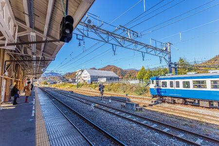 kawaguchi ko: YAMANASHI, JAPAN - NOVEMBER 23  Otsuki Station in Yamanashi, Japan on November 23, 2013  Served by the Chuo Main Line from Tokyo, people make a change here for Kawaguchiko