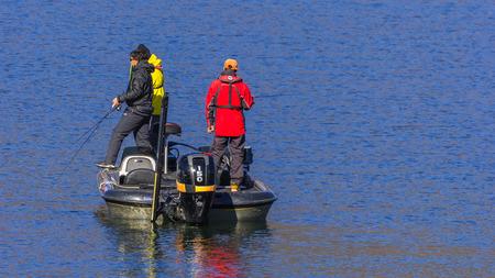 kawaguchi ko: KAWAGUCHIKO, JAPAN - NOVEMBER 22  Fishing People in Kawaguchiko, Japan on November 22, 2013  Unidentified people do the fishing at the Lake Kawaguchi Editorial