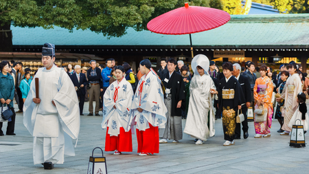 attend: TOKYO, JAPAN - NOVEMBER 23  Wedding Ceremony in Tokyo, Japan on November 23, 2013  Unidentified groom and bride attend a traditional wedding ceremony at Meiji shrine Editorial
