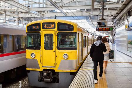 hon: TOKYO, JAPAN - NOVEMBER 23  Seibu Shinjuku Line in Tokyo, Japan on November 23, 2013  Owned by Seibu Railway, running from Seibu Shinjuku to Hon-Kawagoe Station