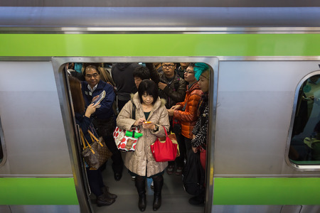 Tokyo, Japan - November 23 2013  Tokyo train is always packed with people all through the day and especially in rush hours
