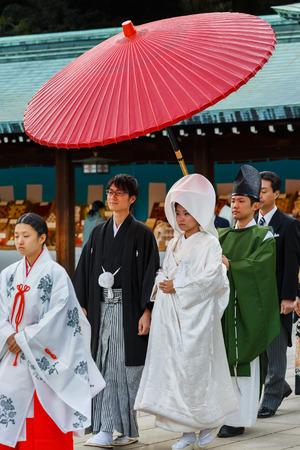 TOKYO, JAPAN - NOVEMBER 23  Wedding Ceremony in Tokyo, Japan on November 23, 2013  Unidentified groom and bride attend a traditional wedding ceremony at Meiji shrine