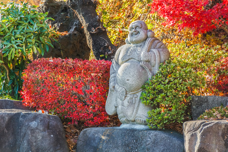 recognised: KAWAGUCHIKO, JAPAN - NOVEMBER 22  Daikokuten in Kawaguchiko, Japan on November 22, 2013  Considered to be the god of wealth, recognised by wide smile face and a flat black hat