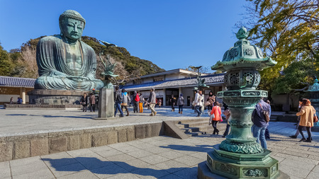 Daibutsu - The Great Buddha of Kotokuin Temple in KamakuraKAMAKURA, JAPAN - NOVEMBER 24  Daibutsu in Kamakura, Japan on November 24, 2013  Constructed in 1252, the bronze statue of Amitabha Buddha located at the Kotokuin Temple
