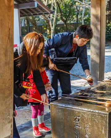 KAMAKURA, JAPAN - NOVEMBER 24  Kotokuin Temple in Kamakura, Japan on November 24, 2013  Wash basin and dippers for washing people