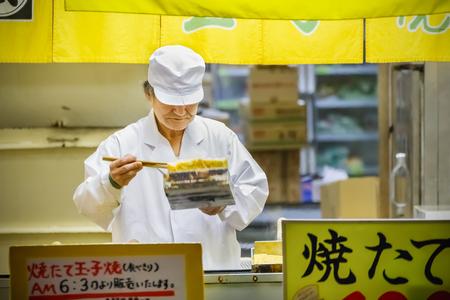 TOKYO, JAPAN - NOVEMBER 25  Tsukiji fish market in Tokyo, Japan on November 25, 2013  Japanese omlette is so poppular for many food shops, it