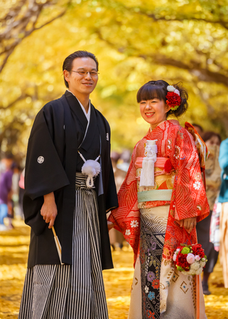 TOKYO, JAPAN - NOVEMBER 26  Japanese Couple in Tokyo, Japan on November 26, 2013  Unidentified groom and bride dress traditional costumes for their wedding ceremony