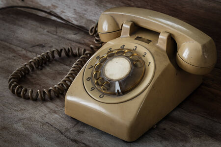 Vintage Telephone on an Old Wood Table photo