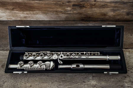 concert flute: Modern Concert Flute on a Wood Table
