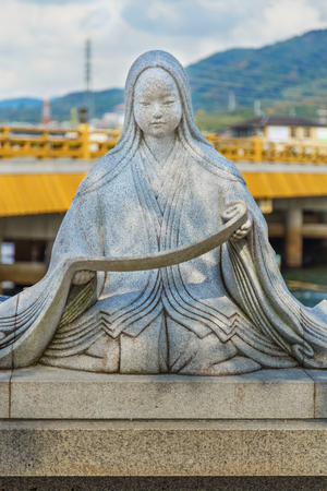 novelist: KYOTO, JAPAN - OCTOBER 21: Murasaki Shikibu statue in Kyoto, Japan on October 21, 2014. A Japanese novelist, poet and lady-in-waiting at the Imperial court during the Heian period, best known as the author of The Tale of Genji Editorial