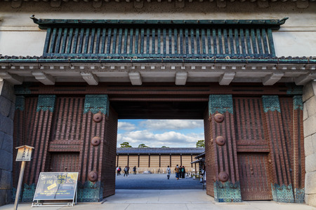 designated: Nijo Castle in Kyoto, JapanKYOTO, JAPAN - OCTOBER 23: Nijo Castle  in Kyoto, Japan on October 23, 2014. A flatland castle, one of the seventeen assets of Historic Monuments of Ancient Kyoto which is designated by UNESCO as a World Heritage Site