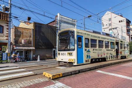 ding: OSAKA, JAPAN - OCTOBER 24: Hankai Tram in Osaka, Japan on October 24, 2014. The Hankai Tramway in Osaka is affectionately known as the chin chin densha (ding ding train).