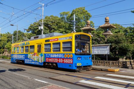 electric tram: OSAKA, JAPAN - OCTOBER 24: Hankai Tram in Osaka, Japan on October 24, 2014. The Hankai Tramway in Osaka is affectionately known as the chin chin densha (ding ding train).