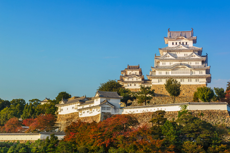 comprising: Himeji Castle in Himeji, Japan  HIMEJI, JAPAN - OCTOBER 25: Himeji Castle in Himeji, Japan on October 25, 2014. Regarded as the finest surviving Japanese castle, comprising a network of 83 buildings with advanced defensive systems from the feudal period