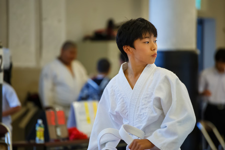 attend: Osaka, Japan - October 25 2014: Unidentified Japanese students attend the Judo class which is a traditional Matial art at Shudokan hall Editorial