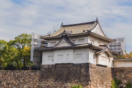 osakajo: Turret at Osaka Castle in Osaka, Japan  OSAKA, JAPAN - OCTOBER 25: Osaka Castle in Osaka, Japan on October 25, 2014. One of Japans most famous and played a major role in the unification of Japan during the 16th century Editorial