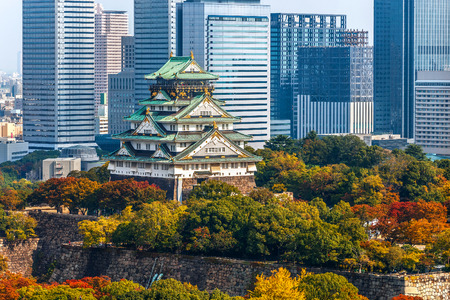 unification: Osaka Castle in Osaka, Japan  OSAKA, JAPAN - OCTOBER 27: Osaka Castle in Osaka, Japan on October 27, 2014. One of Japans most famous and played a major role in the unification of Japan during the 16th century Editorial