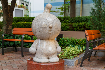 takashi: KOBE JAPAN  OCTOBER 26: Anpanman Character in Kobe Japan on October 26 2014. Stone sculptures of the renowed Japanese cartoon Editorial