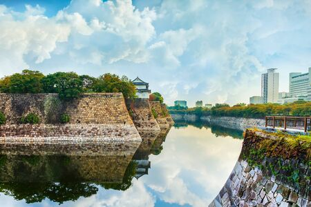unification: Moat of Osaka Castle in Osaka, Japan  OSAKA, JAPAN - OCTOBER 27: Osaka Castle in Osaka, Japan on October 27, 2014. One of Japans most famous and played a major role in the unification of Japan during the 16th century
